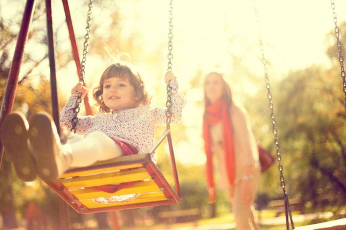 Come fotografare un bambino, tecnica fotografica, altalena